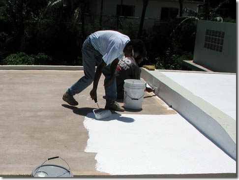 Roofer applying roof coating in Balboa Island, CA